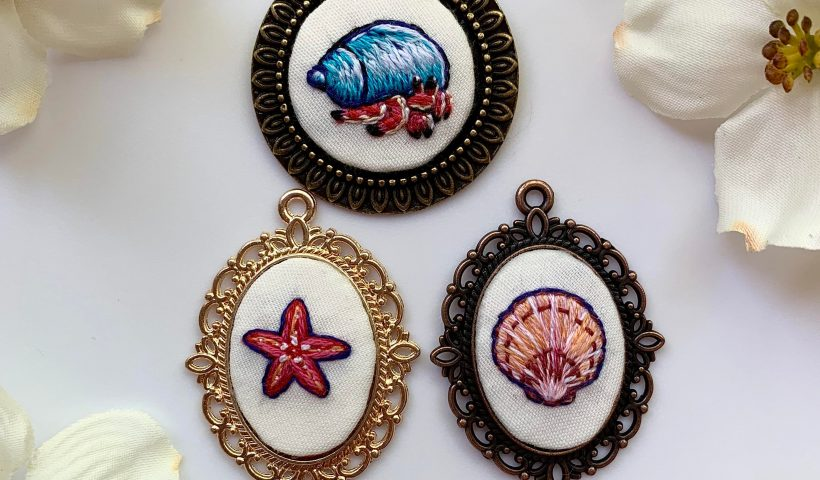 kc0jen61rcy41 820x480 - I can't stop making hand embroidered pendants! My most recent ones are beach themed - hobbies, crafts
